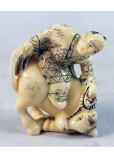 19th Century Japanese Netsuke Man Riding Bull